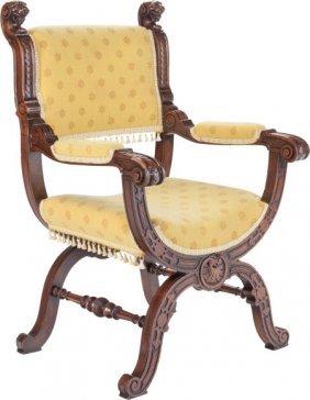 A Renaissance Revival Carved Oak And Upholstered