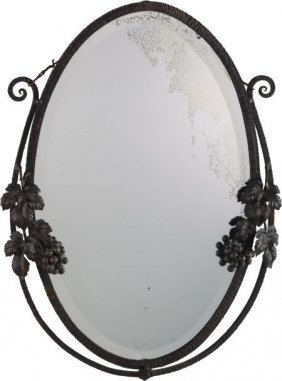 A Continental Art Deco Patinated Metal Mirror In