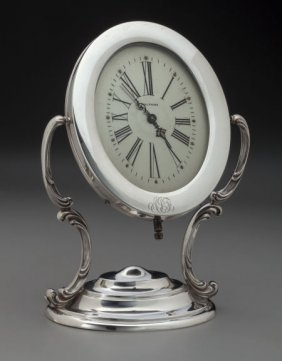 A Reed And Barton Silver Desk Clock With Waltham