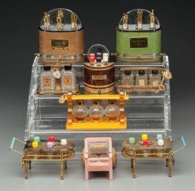 Nine Miniature Novelty Perfume Sets, Circa 1930-