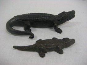 (2) Iron Alligators.