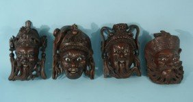 FOUR VIETNAMESE CARVED MASKS, CIRCA 1810