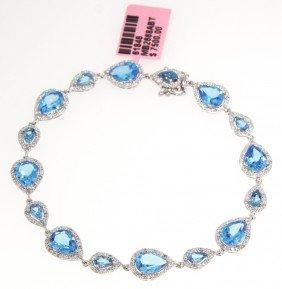 14KT White Gold 11.3ct Blue Topaz And Diamond Bracelet