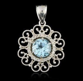 14kt White Gold 3.50ct Blue Topaz & Diamond Pendant