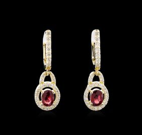1.10ctw Ruby And Diamond Earrings - 14kt Yellow Gold
